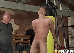 Sub twink bound to a boxing bag and punished by master