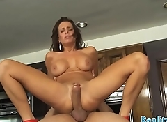 Busty cougar screwed in the kitchen