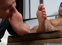 Blayne is muscular jock that is relaxing while getting feet licked