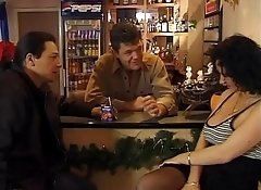 Sexy customer in black stockings fucked by two guys in a bar