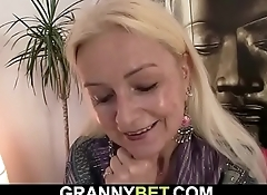 Blonde old granny takes his cock from behind